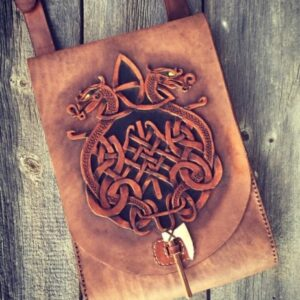 leather crossbody bag with a dragon design
